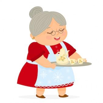 Mrs claus segurando uma bandeja com jarro e xícaras de chá