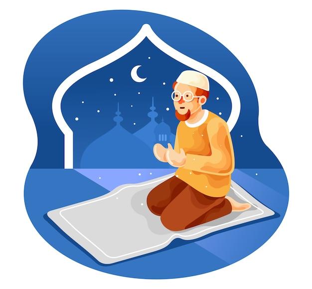 Muçulmano sentado no tapete de oração enquanto rezava