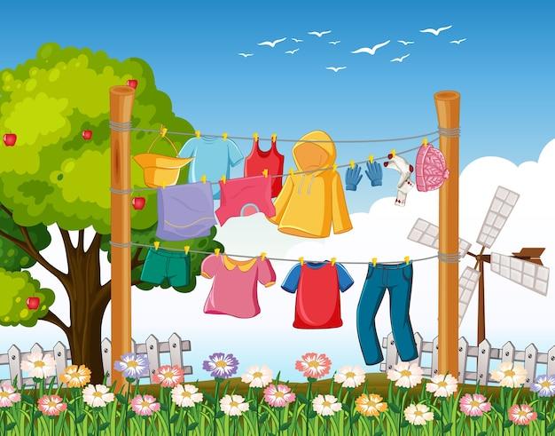 Muitas roupas penduradas em um varal na cena ao ar livre
