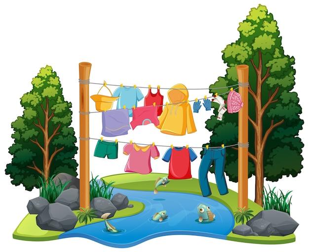Muitas roupas penduradas em uma linha com elementos da natureza
