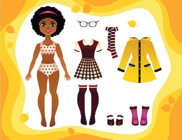 Muito jovem garota afro-americana com uniforme escolar, capa de chuva, botas de borracha e acessórios