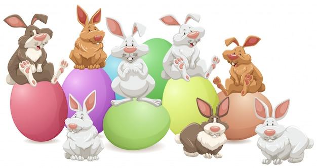 Muitos coelhos em ovos coloridos