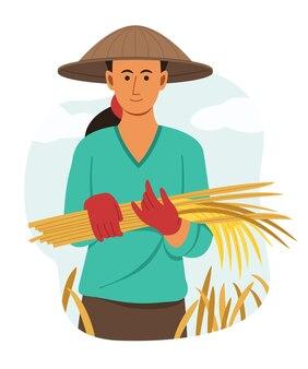 Mulher agricultora asiática segurando o arroz seco