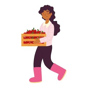 Mulher agricultora com maçãs