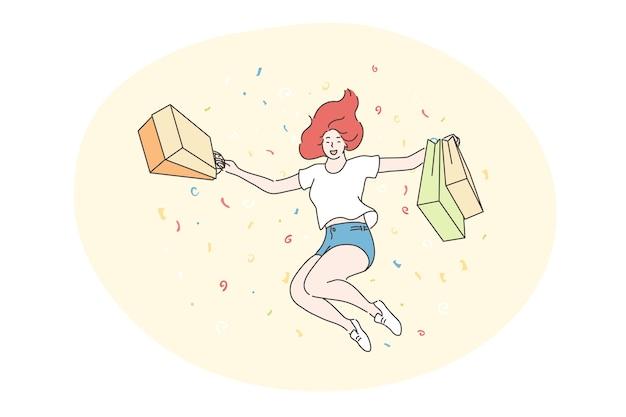 Mulher alegre feliz ou adolescente shopaholic pulando com sacolas de loja.