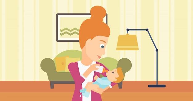 Mulher alimentando o bebê.
