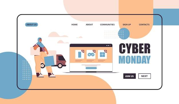 Mulher árabe com sacolas de compras, escolhendo mercadorias na tela do laptop, compras on-line cyber segunda-feira grande venda conceito cópia espaço