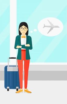 Mulher assustada com o futuro voo