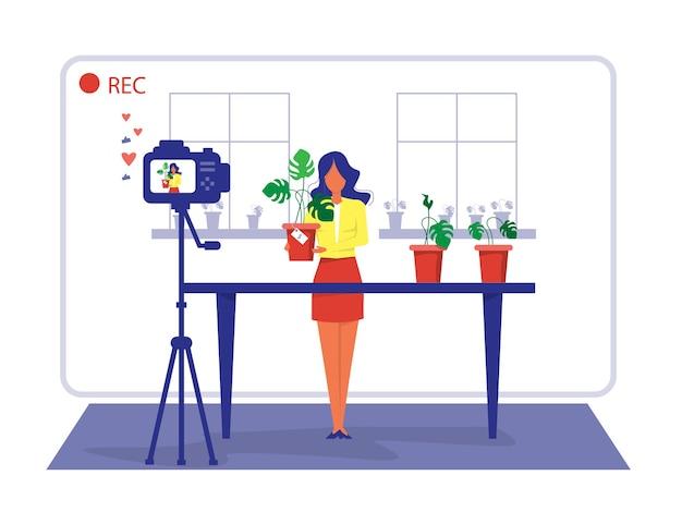 Mulher avaliando ou vendendo planta doméstica por meio da loja on-line de transmissão ao vivo e do conceito de comércio eletrônico