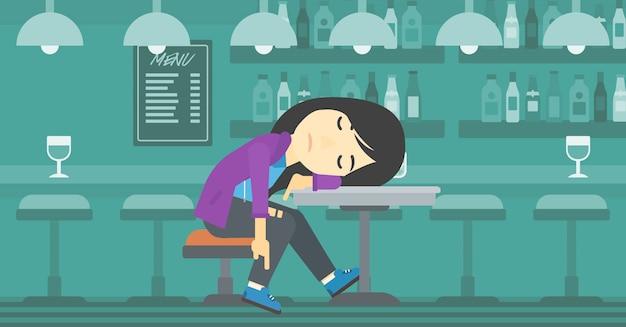 Mulher bêbada dormindo no bar.