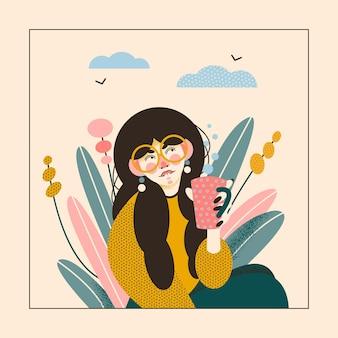Mulher bonita bebendo sua bebida no jardim