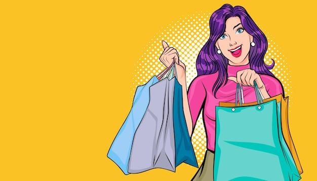Mulher bonita e feliz segurando sacolas de compras estilo pop art comic