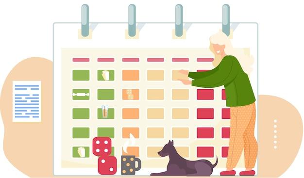 Mulher brincando com cubos e um cachorro