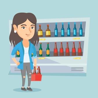 Mulher caucasiana com pack de cerveja no supermercado.