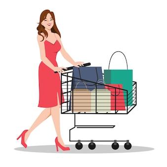 Mulher cliente fazendo compras com conceito de carrinho de mão Vetor grátis
