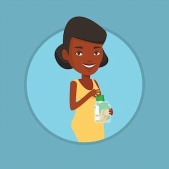 Mulher colocando dinheiro dólar em frasco de vidro.