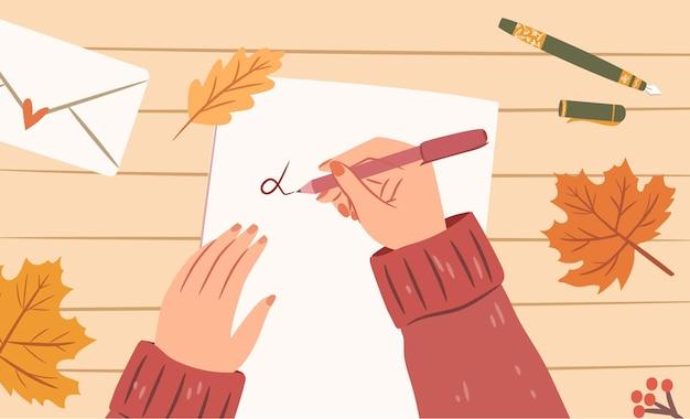 Mulher com as mãos com uma caneta escrevendo uma carta em uma folha de papel vista superior ilustração aconchegante de outono