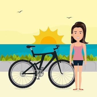 Mulher com bicicleta na paisagem