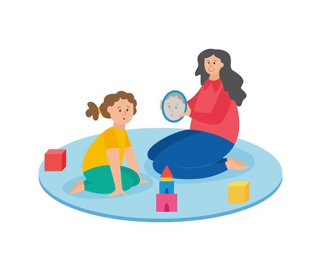 Mulher com criança sentada na aula de terapia da fala e jogando um jogo educativo