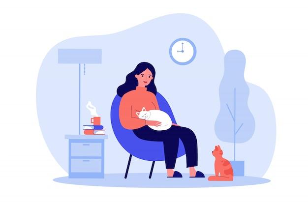 Mulher com gatos no apartamento acolhedor