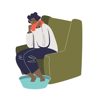 Mulher com gripe, mergulhando os pés em água morna e medindo a temperatura corporal