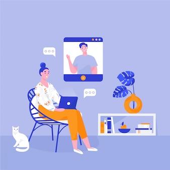 Mulher com laptop sentado em uma cadeira.