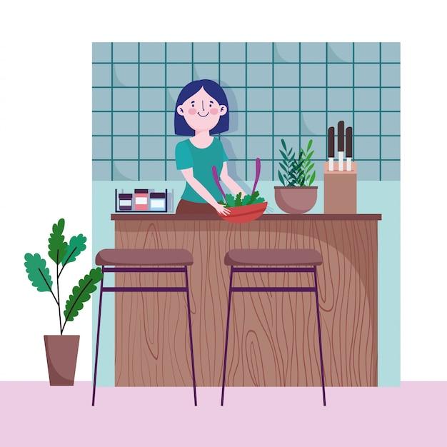 Mulher com legumes na cozinha de balcão de tigela