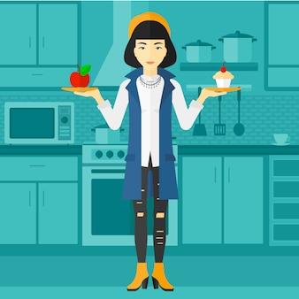Mulher com maçã e bolo.