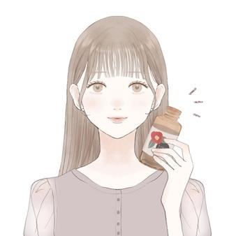 Mulher com óleo de camélia. sobre um fundo branco.