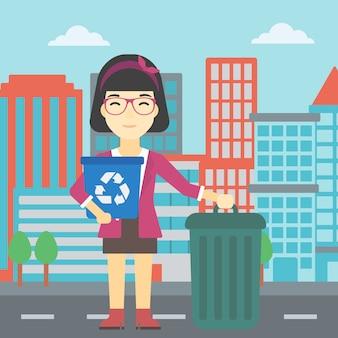 Mulher com reciclagem e lixo pode.
