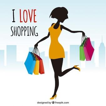 Mulher com sacos de compras