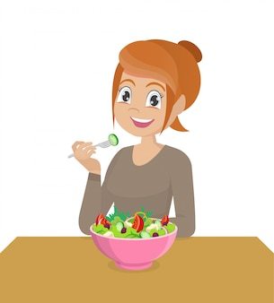 Mulher comendo salada de vegetais saudável.