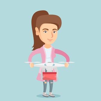 Mulher controlando entrega drone com pacote de postagem