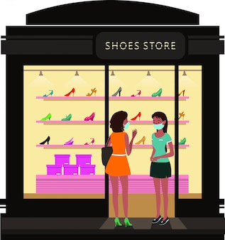 Mulher conversando com a vendedora de uma loja de sapatos