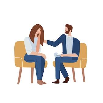 Mulher conversando com psicoterapeuta e chorando psicólogo masculino se senta em uma cadeira e escuta o cli ...