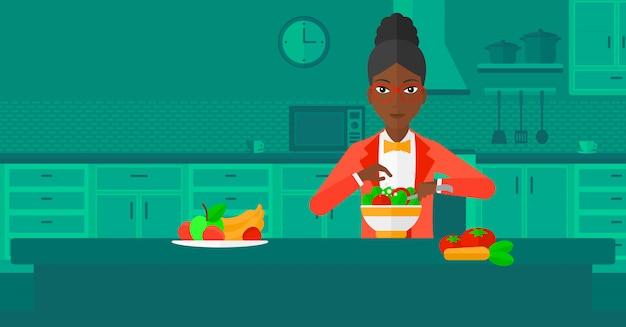 Mulher cozinhando a refeição.