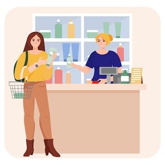 Mulher da loja de cosméticos compra em quiosques de loja de cosméticos perto da caixa registradora v
