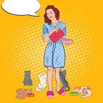 Mulher de arte pop alimentando seus gatos
