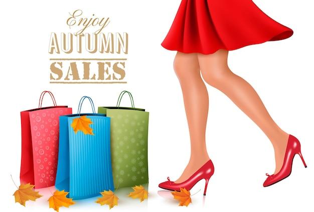 Mulher de compra com vestido vermelho e sapatos de salto alto com sacolas de compras. ilustração vetorial.
