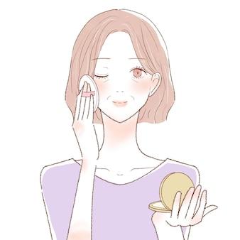 Mulher de meia idade aplicando base em pó no rosto com o puff. sobre um fundo branco.