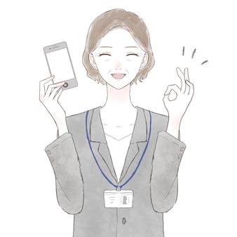 Mulher de meia-idade, vestindo um terno, segurando um smartphone e segurando uma placa de ok. sobre fundo branco.