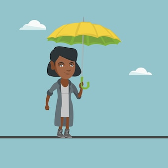 Mulher de negócios na áfrica, equilibrando em uma corda bamba.