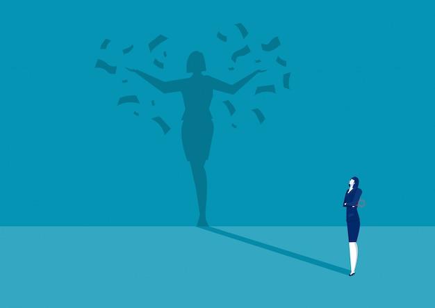 Mulher de negócios olhando sua sombra sob chuva de dinheiro
