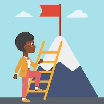 Mulher de negócios subindo na montanha.
