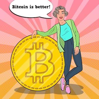 Mulher de sucesso pop art com bitcoin dourado grande