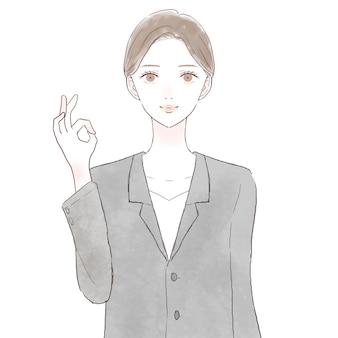 Mulher de terno com sinal de ok. sobre fundo branco.