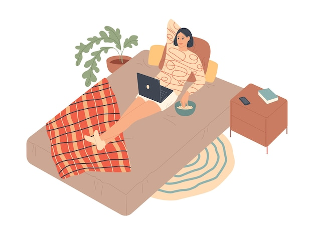Mulher deita-se na cama e assiste à série no laptop.