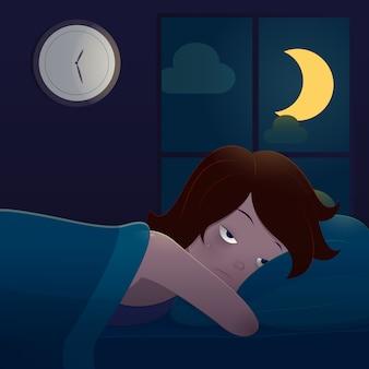 Mulher deitada na cama, sofrendo de insônia