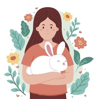 Mulher desenhada a mão segurando uma ilustração de coelho