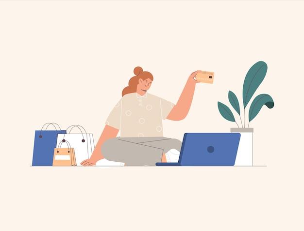 Mulher do conceito de compras online sentada em um laptop, fazendo compras e pagando online